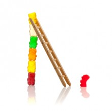 Jelly babies climbing a ladder