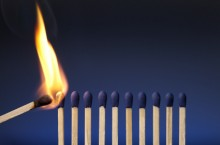 A match lighting a line of other matches
