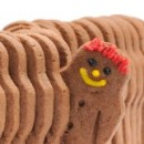 Line of gingerbread men with one peeking out